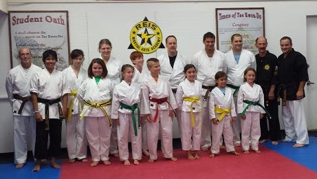 Reis Martial Arts Academy students are pictured with owner Daniel Reis.
