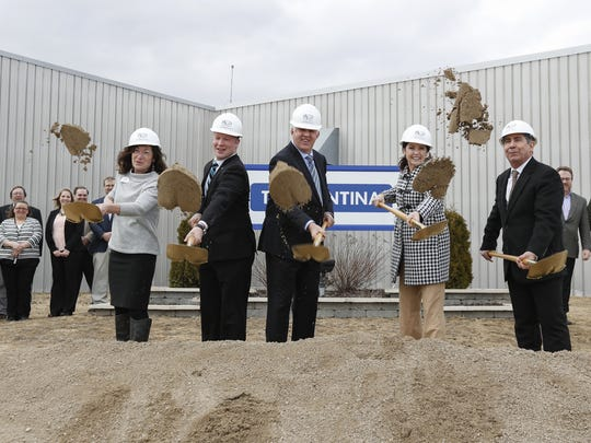 Chamber of Manitowoc County Executive Director Karen Nichols (from left), Manitowoc Mayor Justin Nickels, Tramontina CEO Antonio Galafassi, Wisconsin Lt. Gov. Rebecca Kleefisch and Tramontina VP of Manufacturing Aciel Martins break ground at the site where new offices and a cafeteria will be built Tuesday, March 21, in Manitowoc.