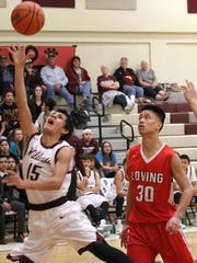 Tularosa's AJ Betancur attempts a layup during the second-half Tuesday night.