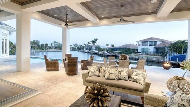 The outdoor living area of Divco's Caxambas model at 446 Kendall Drive on Marco Island.