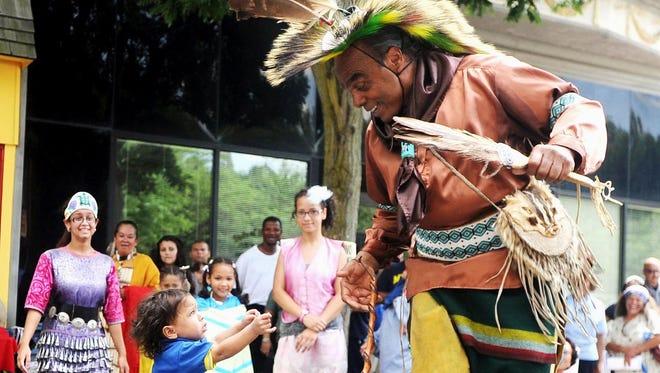 Chief Mark 'Quiet Hawk' Gould of the Nanticoke Lenni-Lenape Tribe dances for his grandson, Mathyias Ellis, during Bridgeton's 325th anniversary celebration in 2011.