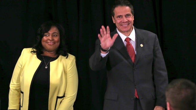 Rochester Mayor Lovely Warren, seen here in a file photo with Gov. Andrew Cuomo in Rochester, said she's not interested in being lieutenant governor.