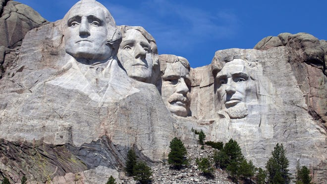 South Dakota - Mount Rushmore is one of the most famous rock formations in the US because it holds the faces of four United States Presidents. Near Keystone, South Dakota George Washington, Thomas Jefferson, Theodore Roosevelt, and Abraham Lincoln will all look down on you from their perch in the mountain. Ah, America!