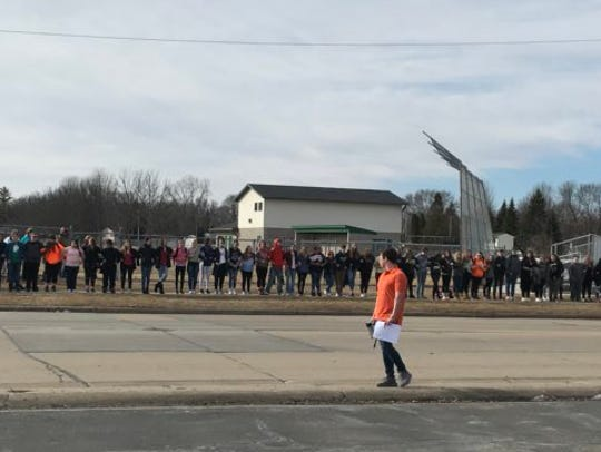 About 100 students gather Wednesday, March 14, 2018,