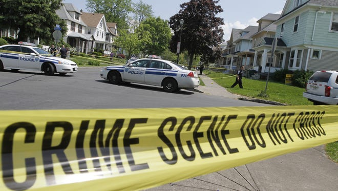 Rochester police tape off the scene of a shooting.