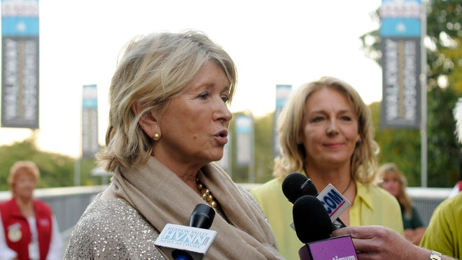 Martha Stewart answers questions from the media gathered at the Walkway Over the Hudson's Starry Starry Night benefit on Friday. At right is Elizabeth Waldstein-Hart, executive director of Walkway Over the Hudson.