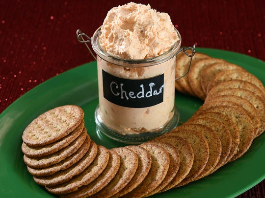 A gift of Cheddar Spread with crackers is a welcome relief from other holiday sweets.
