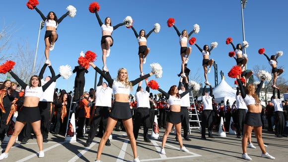 Oregon State University cheerleaders perform for fans prior to Civil War Friday, Nov. 27, 2015, at Autzen Stadium in Eugene, Ore.
