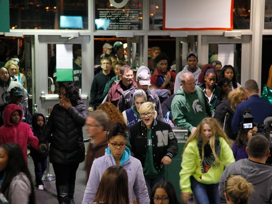 Michigan State fans rush into the Breslin Center after