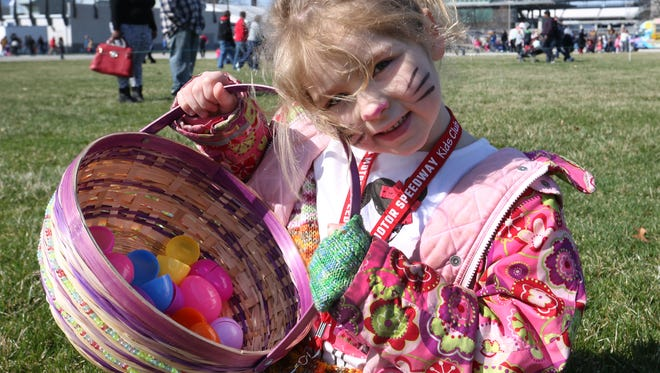 Scout Marien found 13 plastic Easter eggs during the Indianapolis Motor Speedway's egg hunt in 2015. All the eggs were snatched up within a minute or two by the hundreds of children whose parents brought them to the hunt on the IMS infield grass.