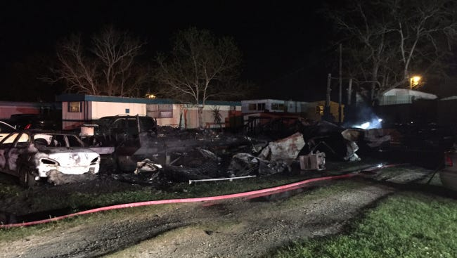 An early-morning fire destroyed several homes and vehicles in Iberia Parish.