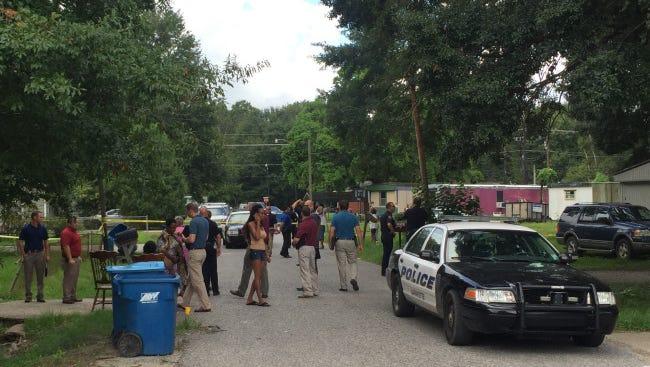 Police investigate a reported death on Conrad Street in Lafayette Monday.