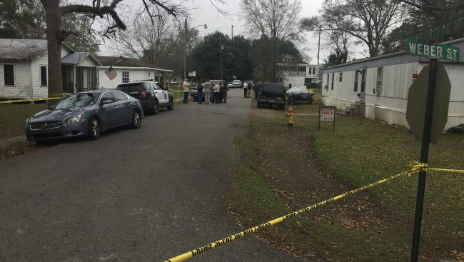 The road 75-year-old Howard Poche's home is located is blocked off Wednesday. Poche's body was found near his home.