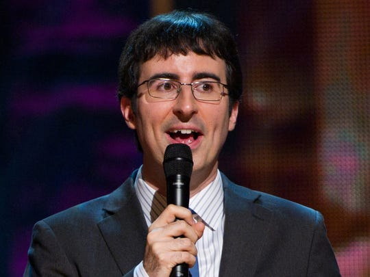 """In this Oct. 2, 2010 file photo, John Oliver appears on stage at Comedy Central's """"Night Of Too Many Stars: An Overbooked Concert For Autism Education"""" at the Beacon Theatre in New York."""