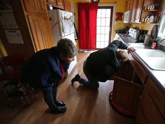 Carolyn Schaefer, a registered nurse and healthy homes specialist, and Mike Miller, a city of Des Moines code enforcement officer inspect a home for environmental causes of asthma on Tuesday, March 1, 2016, in Des Moines. Schaefer looks at things like vents and flooring and Miller puts together a bid for the cost of changes to the home.
