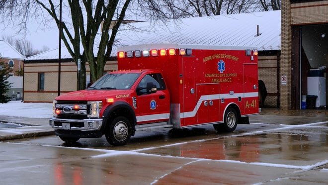 An ambulance from the Adrian Fire Department leaves on a medical call Sunday.