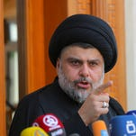 Shiite cleric Muqtada al-Sadr speaks during a media conference in Najaf, Iraq, 100 miles south of Baghdad, Saturday as hundreds of his supporters stormed the Green Zone government center in Baghdad.