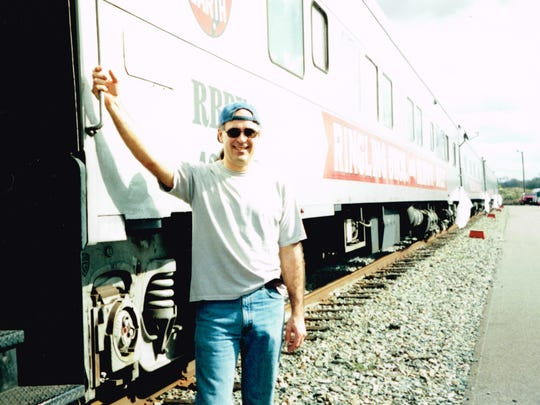 Dave Nichols in a train yard in Augusta, Ga., during