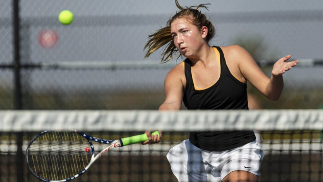 Sacred Heart-Griffin's Agnes Cross returns a shot against Rochester's Claire Gray in the second round of singles play during the CS8 Tournament at Glenwood High School, Friday in Chatham.