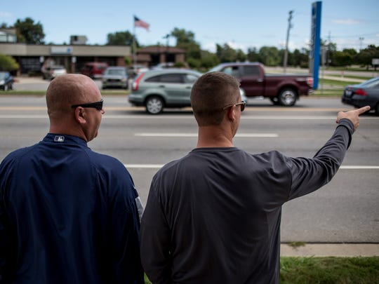 St. Clair County Sheriff's Deputy Russ Nowiski and Sgt. Matt Pohl watch for distracted drivers Wednesday, September 14, 2016 on 24th Avenue near Keewahdin Road in Fort Gratiot.