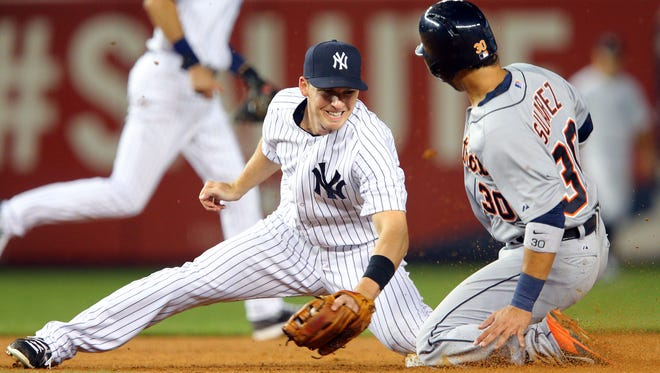 Tigers shortstop Eugenio Suarez, right, steals second base ahead of the tag of Yankees second baseman Stephen Drew on Monday.