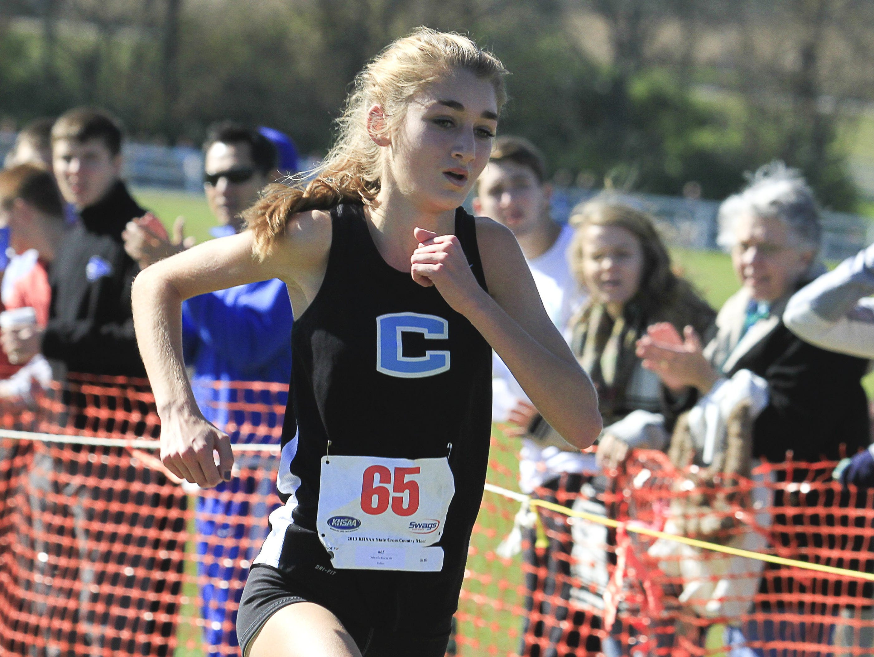 Collins' Gabriella Karas, shown winning last year's state meet, made it four straight titles in Class 2-A.