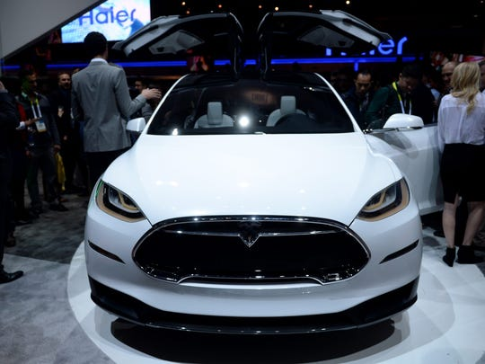 Concept car 'Model X ' of electric powered car manufacturer Tesla is on display at the stand of electonics manufacturer Panasonic during the 2015 International Consumer Electronics Show (CES) in Las Vegas in January.
