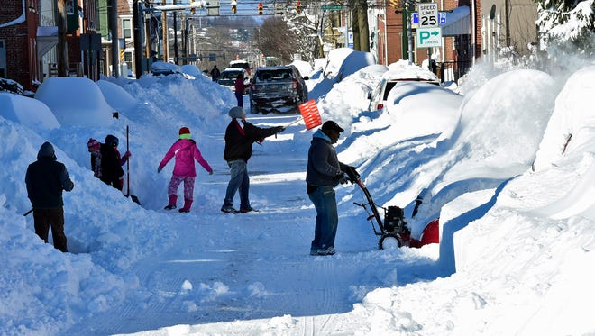 People with shovels and snowblowers are digging out of East Washington Street, Chambersburg Sunday, Jan. 24, 2016. Winter storm Jonas dropped a few feet of snow in the area over the weekend.  (Via OlyDrop)