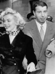 Joe DiMaggio with Marilyn Monroe.