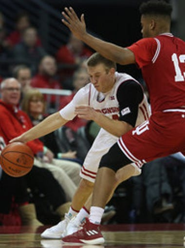 Wisconsin guard Brad Davison drives on Indiana forward