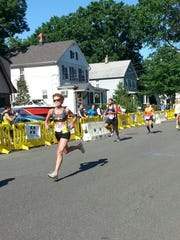 Marisa Sutera Strange zooms during the New Milford Fire Department 5-kilometer race in New Jersey.