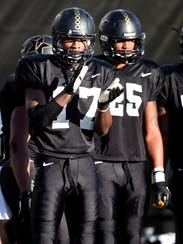 Vanderbilt cornerback Joejuan Williams (17) encourages