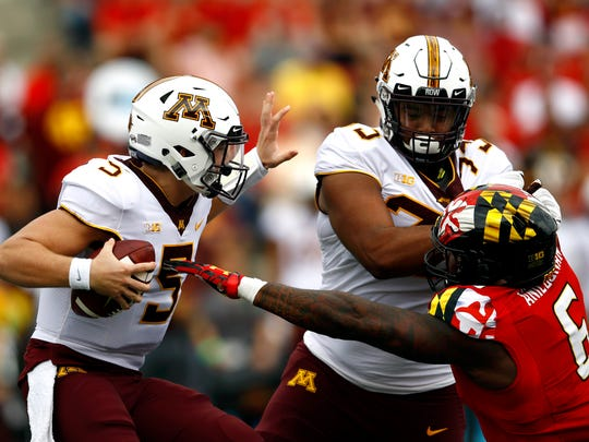 Minnesota quarterback Zack Annexstad protects the football under pressure from Maryland defensive lineman Jesse Aniebonam on Sept. 22. The Gophers' freshman was sacked four times, intercepted twice and lost one fumble in a 42-13 loss.