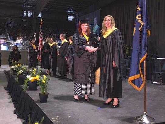 High School graduate Bailey Robinson from Scio shakes