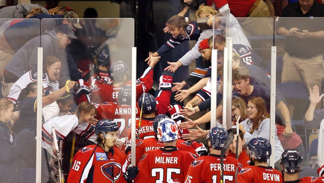 Fans congratulate the South Carolina Stingrays who defeated the Florida Everblades 2-1 to win the South Division Kelly Cup best-of-seven series 4-1 Thursday, May 3, 2017 at the North Charleston Coliseum.