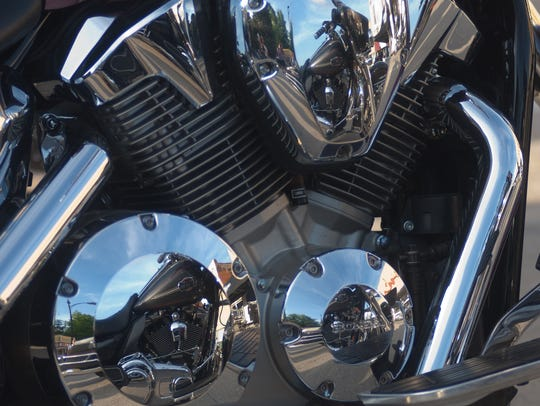 The Indianola square is reflected in the chrome of a motorcycle engine during a Bike Night in 2013