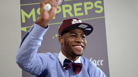 Malik Newman rings a cowbell Friday, April 24, 2015 after announcing that he'll play basketball at Mississippi State University.
