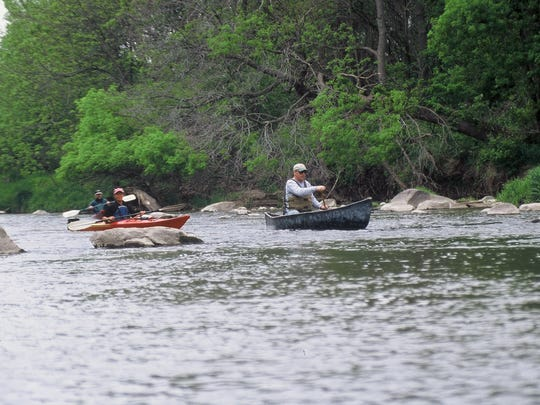Paddlers take on the twists and turns of Lizard Creek near Fort Dodge.