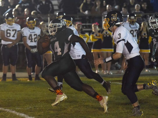 Spackenkill's Dhyquem Lewinson takes the ball down