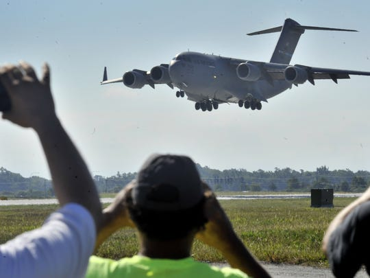 A C-17 Globemaster III,  assigned to the 3d Airlift Squadron at Dover AFB seconds from touching down on runway 01.
