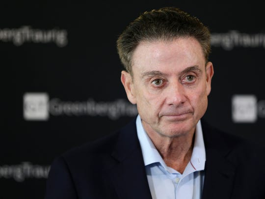 FILE- In this Feb. 21, 2018 file photo, former Louisville basketball Hall of Fame coach Rick Pitino talks to reporters during a news conference in New York. A recruiter, a coach and a former Adidas executive are scheduled to go on trial in New York in a criminal case that exposed corruption in several top U.S. college basketball programs. It also led to the firing of Pitino and sidelined the playing career of standout recruit Brian Bowen Jr. (AP Photo/Seth Wenig, File)