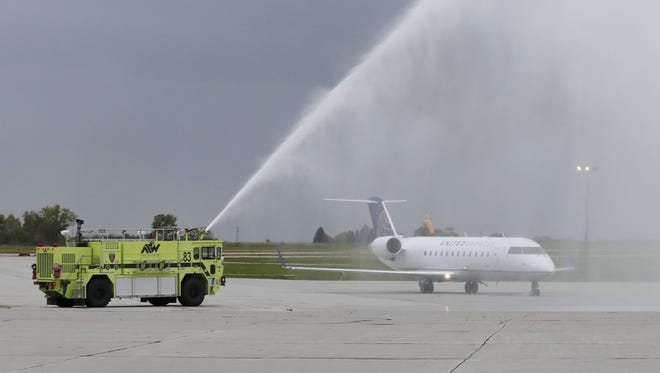 Air Wisconsin Airlines, flying as United Express, is welcomed with a water cannon salute late last year at the Appleton International Airport in Greenville.