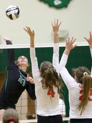 West Branch's Jessica Bock, left, spikes the ball against Northwest in a tournament match in October 2019.