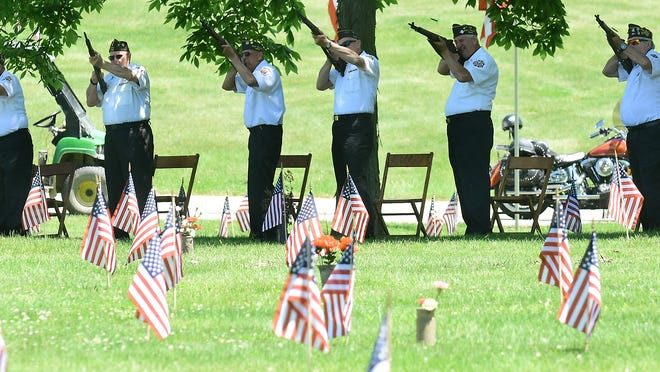 The Honor Guard shoots a salute at the Northlawn Memorial Garden event on Memorial Day, 2019. Kevin Graff, MyTownNEO.com