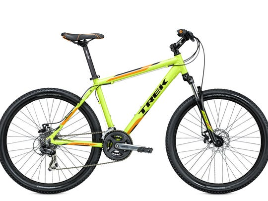 An open quick release lever on models of Trek bicycles on the bicycle's front wheel hub can come into contact with the front disc brake assembly, causing the front wheel to come to a sudden stop or separate from the bicycle, posing a risk of injury to the rider.