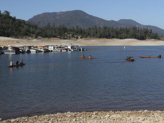 File photo - The Winnemem Wintu and supporters left the Jones Valley boat ramp in dugout canoes and a patio boat Wednesday as they finish their 300-mile prayer journey from the Bay Area to the historical spawning grounds of the winter-run salmon on the McCloud River to raise awareness for salmon and water issues.