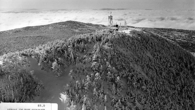 An early view of the summit at Killington with clouds over the valley.