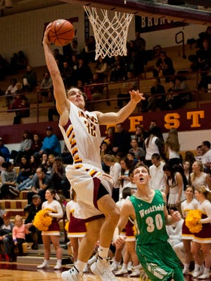 Haden Deaton drives the lane for a dunk against Westfield Friday. Deaton had 13 points as McCutcheon defeated Westfield 55-35.