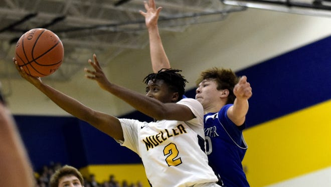 Moeller's Isaiah Payton (2) powers his way to the basket. Jan. 13, 2018. Moeller beat St. Xavier, 75-52.