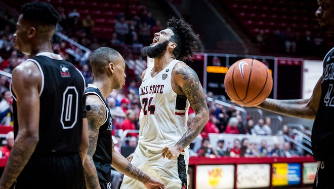 Ball State's Trey Moses celebrates during their game against Northern Illinois' defense during their game at Worthen Arena Tuesday, Feb. 20, 2018.